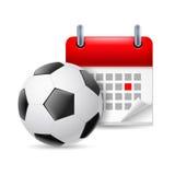 橄榄球和日历 库存照片
