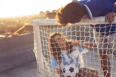 橄榄球和爱 免版税库存照片