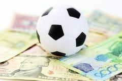 橄榄球和金钱足球贝蒂 库存图片
