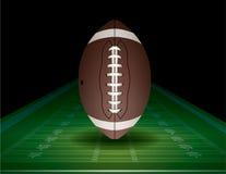 橄榄球和领域例证 免版税库存照片
