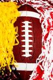 橄榄球和Pom Poms 免版税库存图片