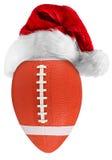 橄榄球圣诞老人帽子 免版税库存照片