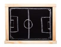 橄榄球在黑板的战略计划 免版税库存图片