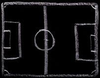 橄榄球在黑板的战略计划 免版税图库摄影