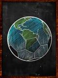 橄榄球地球剪影黑板 免版税库存照片