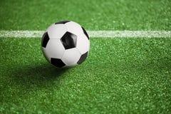橄榄球场和球 免版税库存照片