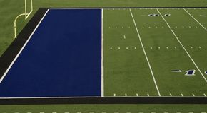 橄榄球场蓝色端线区 库存照片