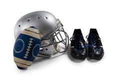 橄榄球大角度看法与体育鞋子和盔甲的 免版税库存照片