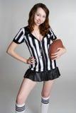 橄榄球女孩藏品裁判 库存图片