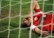 橄榄球或足球运动员伤害痛苦 免版税库存图片