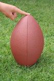 橄榄球拿着喷射器安排 图库摄影