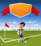 橄榄球的年轻男孩 免版税库存照片