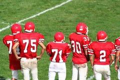 橄榄球高中小组 库存照片