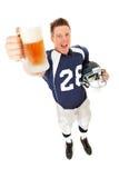 橄榄球:为啤酒激发的球员 图库摄影