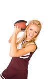 橄榄球:啦啦队员投掷的球 免版税库存图片