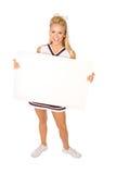 橄榄球:拿着空白的标志的啦啦队员 免版税库存图片