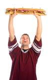 橄榄球:爱好者是立即可食的大三明治 免版税库存照片