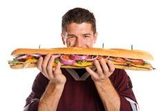 橄榄球:爱好者是立即可食的大三明治 库存照片