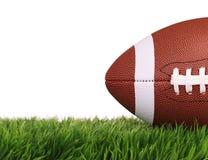 橄榄球 在绿草的球,被隔绝 免版税库存照片