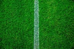 橄榄球/足球场新草背景,纹理 库存图片
