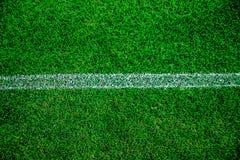 橄榄球/足球场新草背景,纹理 免版税库存图片
