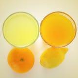 橙汁和柠檬汁 免版税库存图片