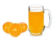 橙汁和桔子 免版税库存图片