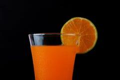 橙汁和片式桔子 免版税库存图片