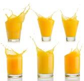 橙汁在白色飞溅被隔绝的集合 库存照片