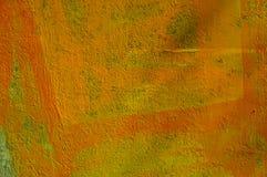 橙油被绘的墙壁 免版税库存图片