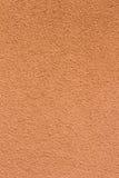 橙红色意大利灰泥墙壁纹理背景 免版税库存照片