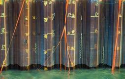 橙色丝带在水中 免版税库存照片