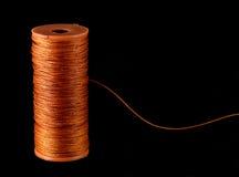 橙色严格的线程数 库存照片