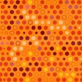 橙色传染媒介小点,圈子无缝的背景 免版税库存图片
