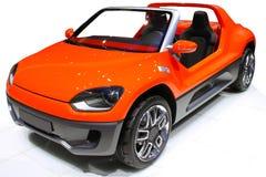橙色儿童车 免版税库存照片