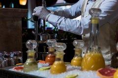 橙色剥削者和汁液 免版税库存图片