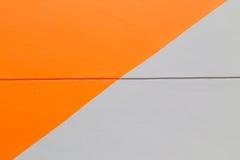 橙色和灰色墙壁摘要背景纹理 免版税库存图片