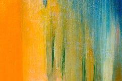 橙色和蓝色油漆形式绿色 免版税库存照片