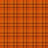 橙色和黑色格子花呢披肩织品背景 免版税库存照片