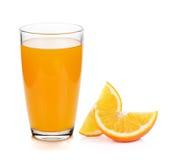 橙色和玻璃用汁液 免版税库存图片