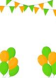 橙色和绿色旗布和气球 库存照片