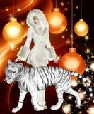 橙色圣诞节背景的老虎妇女 免版税库存照片