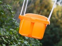 橙色塑料摇摆 图库摄影