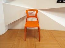 橙色塑料椅子 免版税库存照片