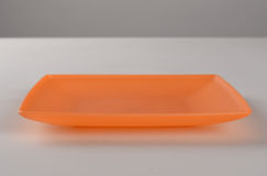橙色塑料碗 免版税库存图片