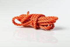 橙色塑料绳索 库存照片