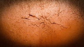 橙色墙壁的纹理 免版税库存图片
