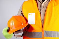 橙色夹克成套装备藏品盔甲特写镜头的工作者 免版税库存照片