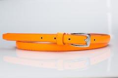橙色女性传送带 小圆盾 图库摄影