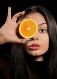 橙色妇女 库存图片
